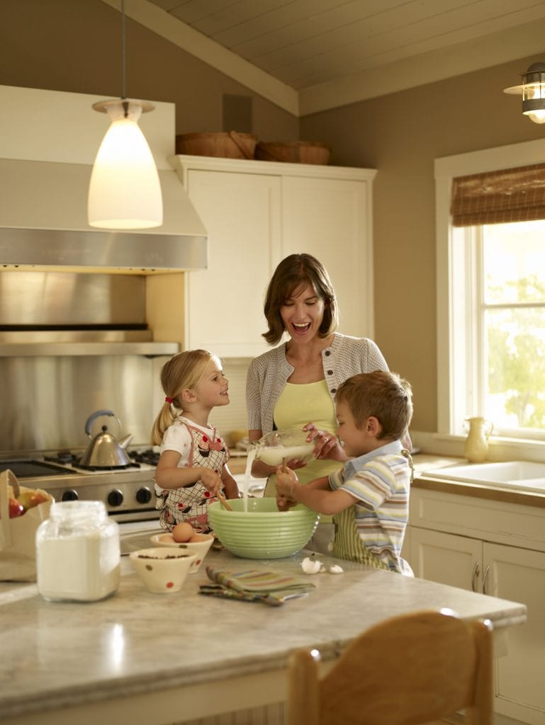 Woman baking with her children