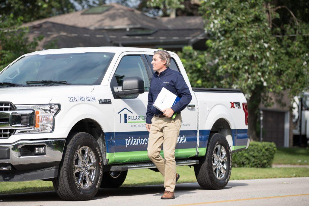 Home Inspector walking away from truck