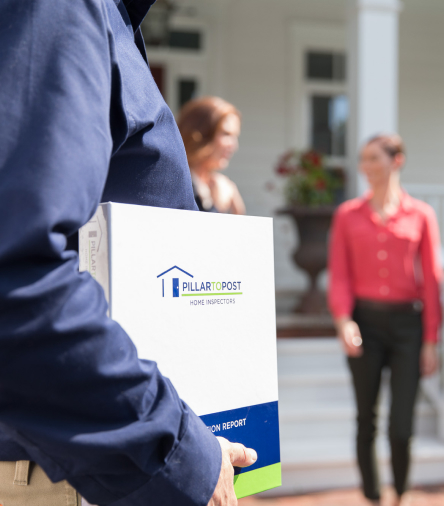Home Inspector holding a binder with the home inspection report
