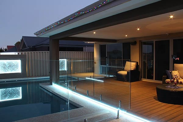 Modern backyard deck with pool
