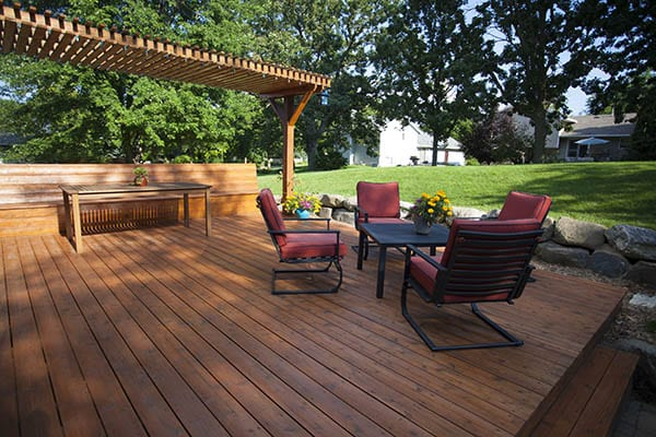 Back yard deck with tables and chairs