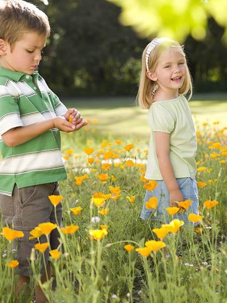 Children in a field of flowers