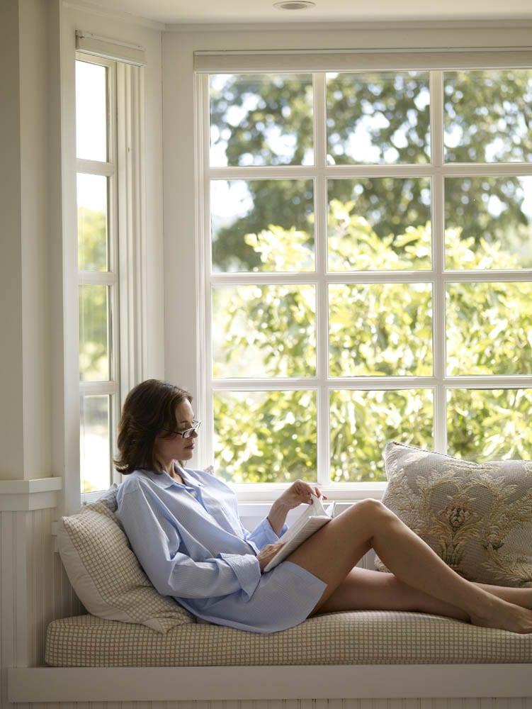 Woman reading in bay window