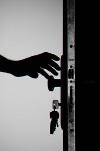 Hand near door knob