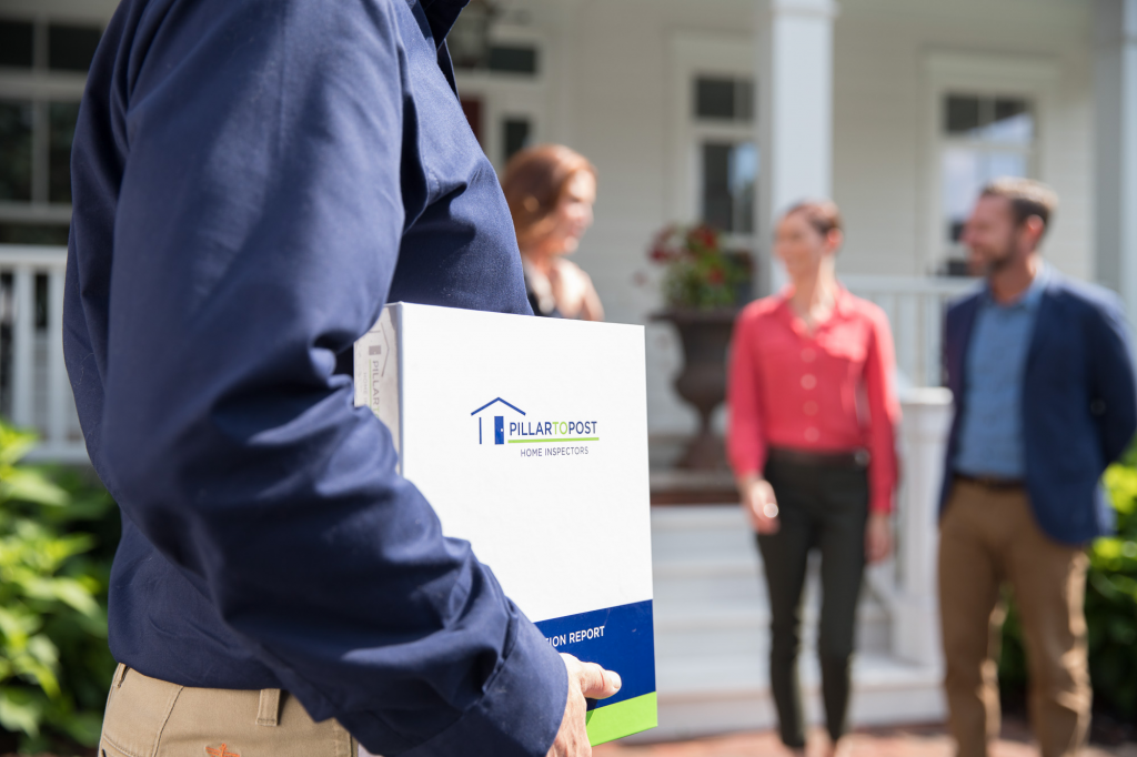 Home Inspector holding a report binder